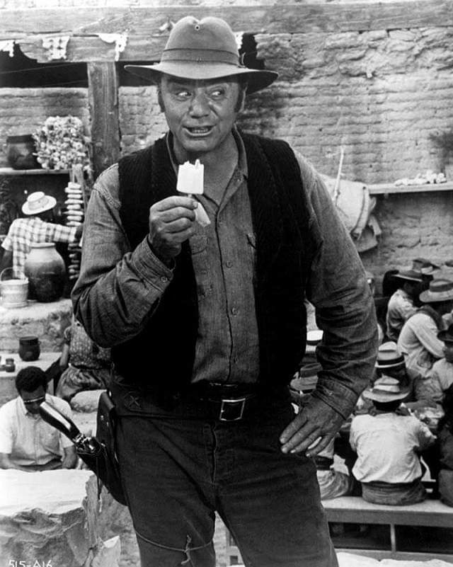 #actor #Throwback #movie #behindthescenes Ernest Borgnine enjoying A #popsicle filming The Wild Bunch.