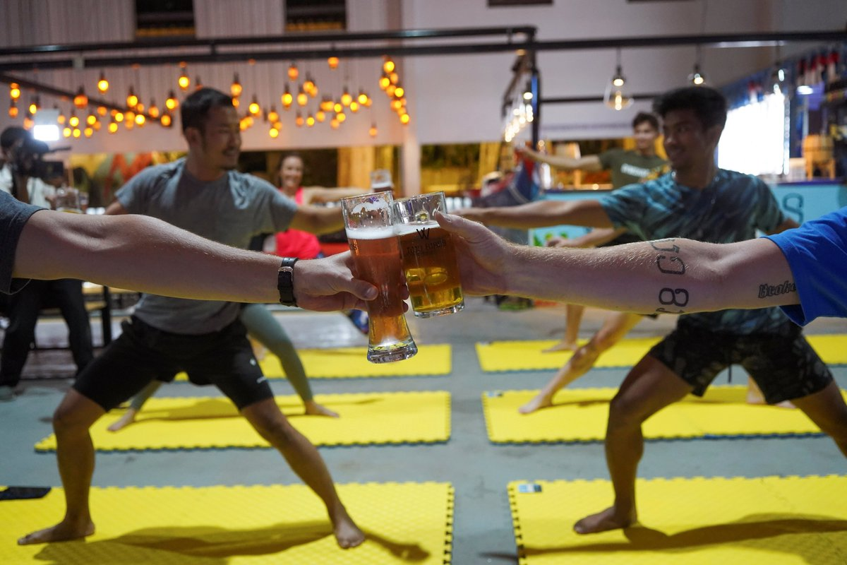 Alcohol and exercise...at the same time? Why not! 🍺🧘♀️ Beer yoga resumes at a brewery in Phnom Penh after a six-week lockdown across Cambodia. (via Reuters) FULL STORY: reut.rs/2NojHnu