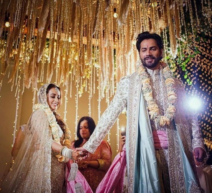 This is honestly such a fairytale-like wedding just like their love story. The smiles on their faces, the way they are protectively holding each other's hands. Everything about these pics is just beautiful. It feels surreal :') @Varun_dvn I'm SO happy for you💕 #NatashaGotDhaOne