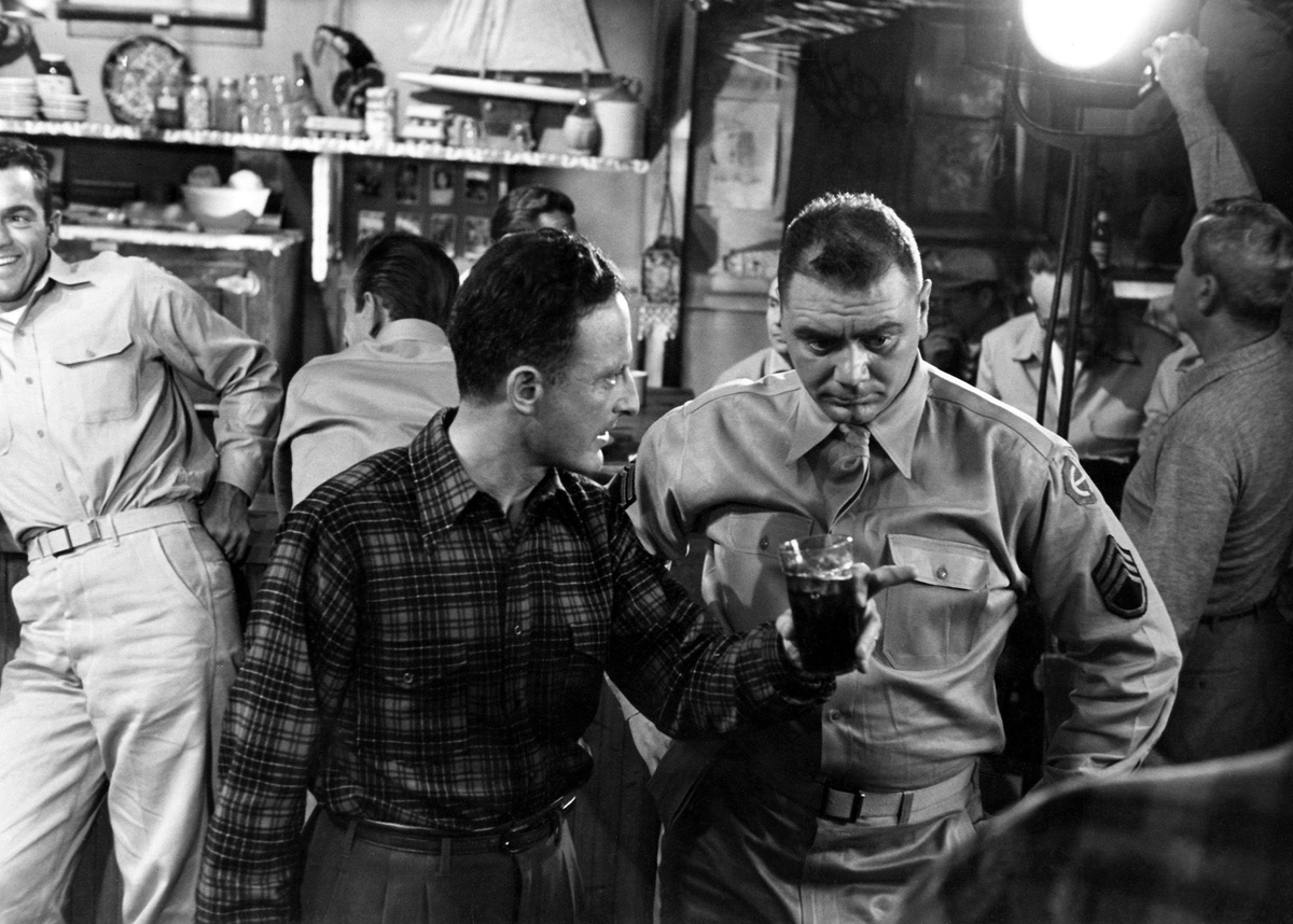 Ernest Borgnine (#bornonthisday) with director Fred Zinnemann on the set of From Here to Eternity (1953). #ErnestBorgnine #movies #behindthescenes #film #vintagehollywood #January24 #RealButterHistory