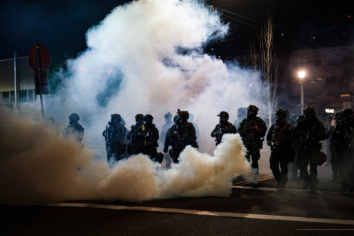 """Abolish ICE protest Portland, Oregon 1/23/21  Federal agents emerge from billowing clouds of tear gas as they continue to fire less-lethal"""" ammunitions into the crowd.  #PDX #protest #Portland #PortlandProtests #pdxprotest #Oregon #antifa #Police #AbolishICE"""