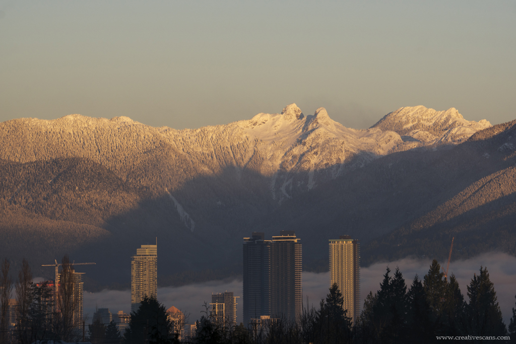 Fog in the city with twin peaks of the Lions in the background.  . . #explorebc #photos604 #beautifulbc #pacificnorthwest #life_in_canada #outdoors #shareyourweather #mountains #snow #fog #burnaby365