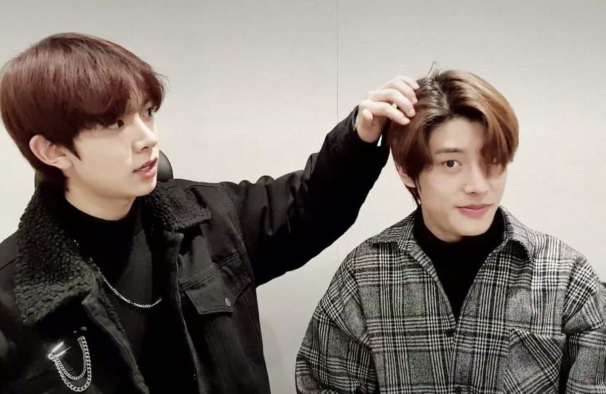 Replying to @hourly_lhs: Heeseung fixing jake's hair is the most precious thing you'll see today