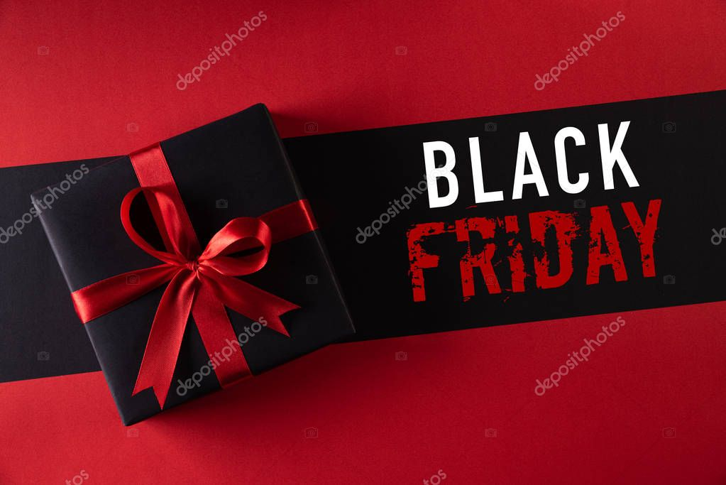 Top view of black christmas boxes with red ribbon on black background. Photo by Spukkato #BlackFriday #Background https://t.co/wDXW4s5cLp https://t.co/0dJP3wFLwj