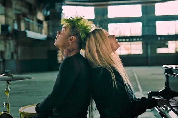 ".@MODSUN & @AvrilLavigne rock out in their explosive ""Flames"" video:"