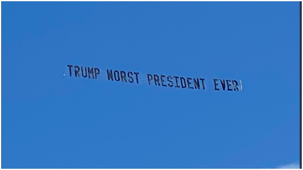 """WATCH: Trump trolled with """"worst president ever"""" banner flown near Mar-a-Lago https://t.co/599CFxyUGk https://t.co/QWRgt9rJMS"""