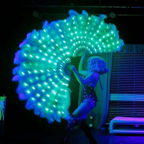 Photo from Catch Jazida of my LED feather fans which @flowerofrhode recently drew!  Pic by @davidlmackie.photography  #featherfan #led #lightdance #ostrichfeathers #fandance #fandancing #burlesque #fandancer #ledlights #lightup #light #lights