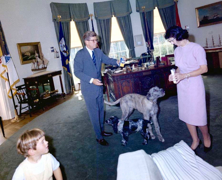 JFK in eyeglasses with dogs and canine treats in Oval Office (with son John and secretary Evelyn Lincoln), 1963:             #JFKL