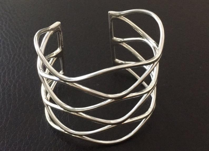 Time to make some waves! Solid Sterling Silver Negative Space Wavy Cuff Bracelet. Video  #sterlingsilver #cuff #bracelet #waves #beach #negativespace #etsy