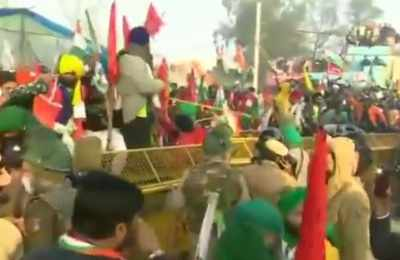 Farmers at Tikri border enter Delhi breaking police barricade  Farmers' tractor rally live updates: