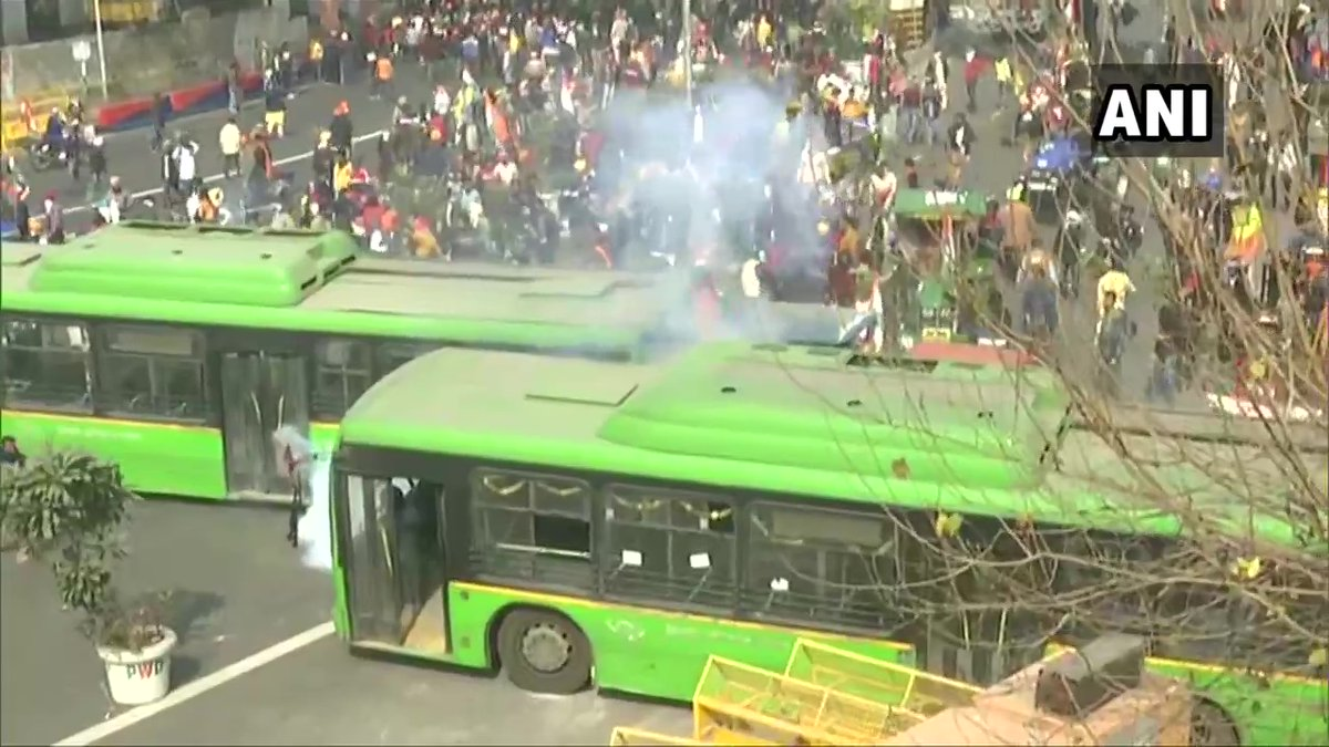 Police use tear gas shells to disperse the protesting farmers at ITO in central Delhi.   #FarmersLaws