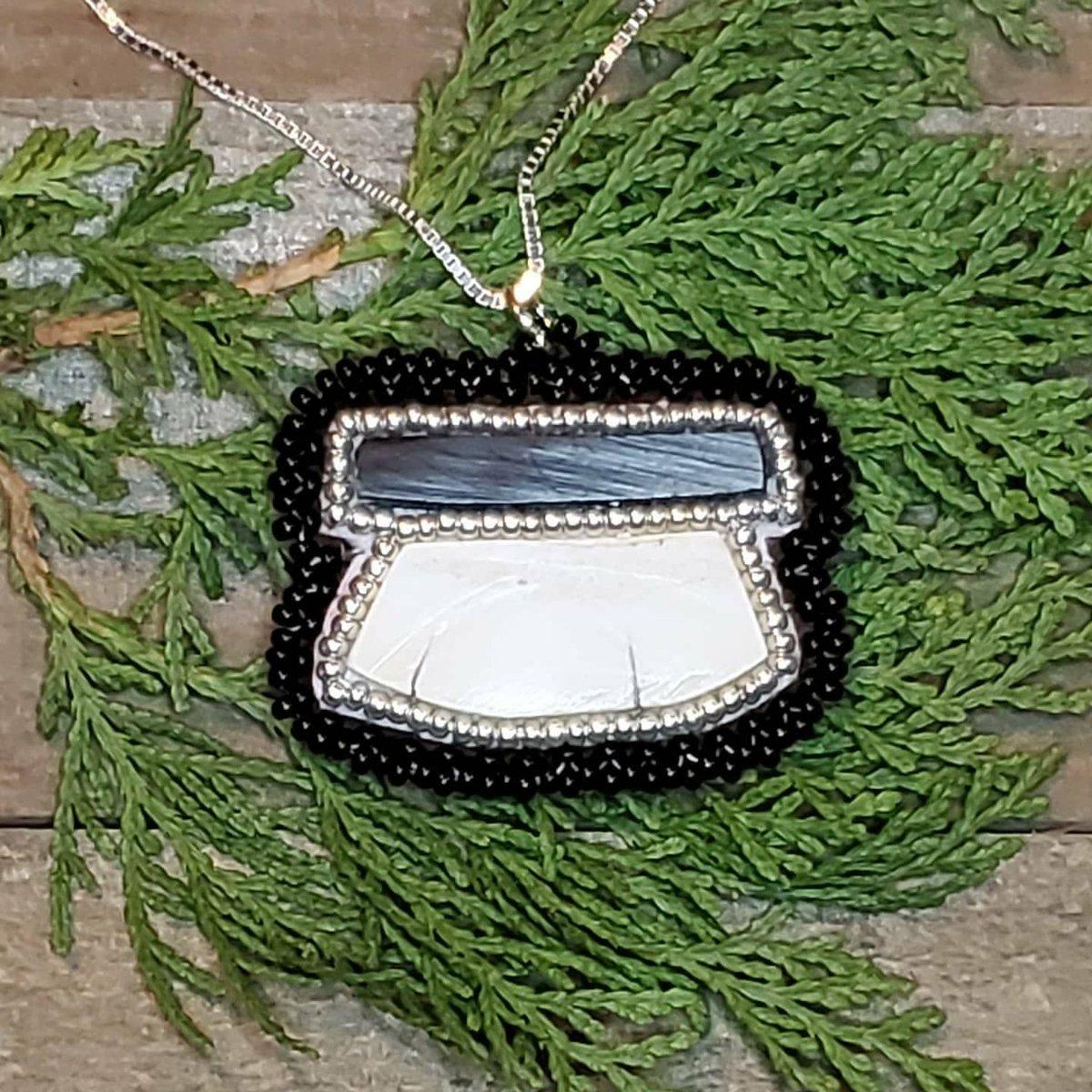 Baleen & walrus ivory ulu pendant with a .925 sterling silver chain, available on my IG lovealaskabeads.  #NativeTwitter #beadwork #AlaskaNative #FirstNations #NativeMade #BuyNative #Statimc #Unangax #Aleut #ivory #baleen