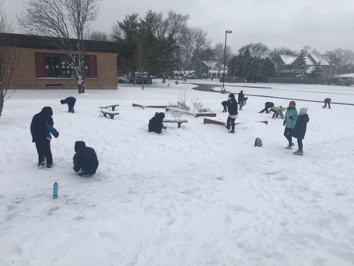 It's was a fun and #snowy mask-break for the students in Mrs. Lipnisky's class today. They had a snowball making contest. The winner rolled 16 in one minute! #snow #winter #YourCommunitySchools
