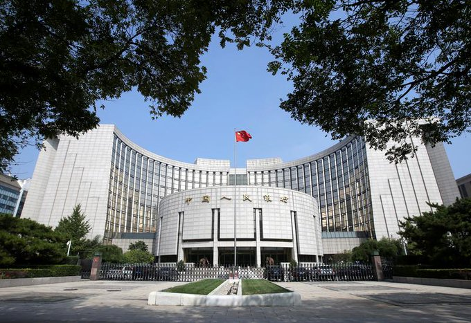 China central bank will back growth and watch debt risks, says governor Photo