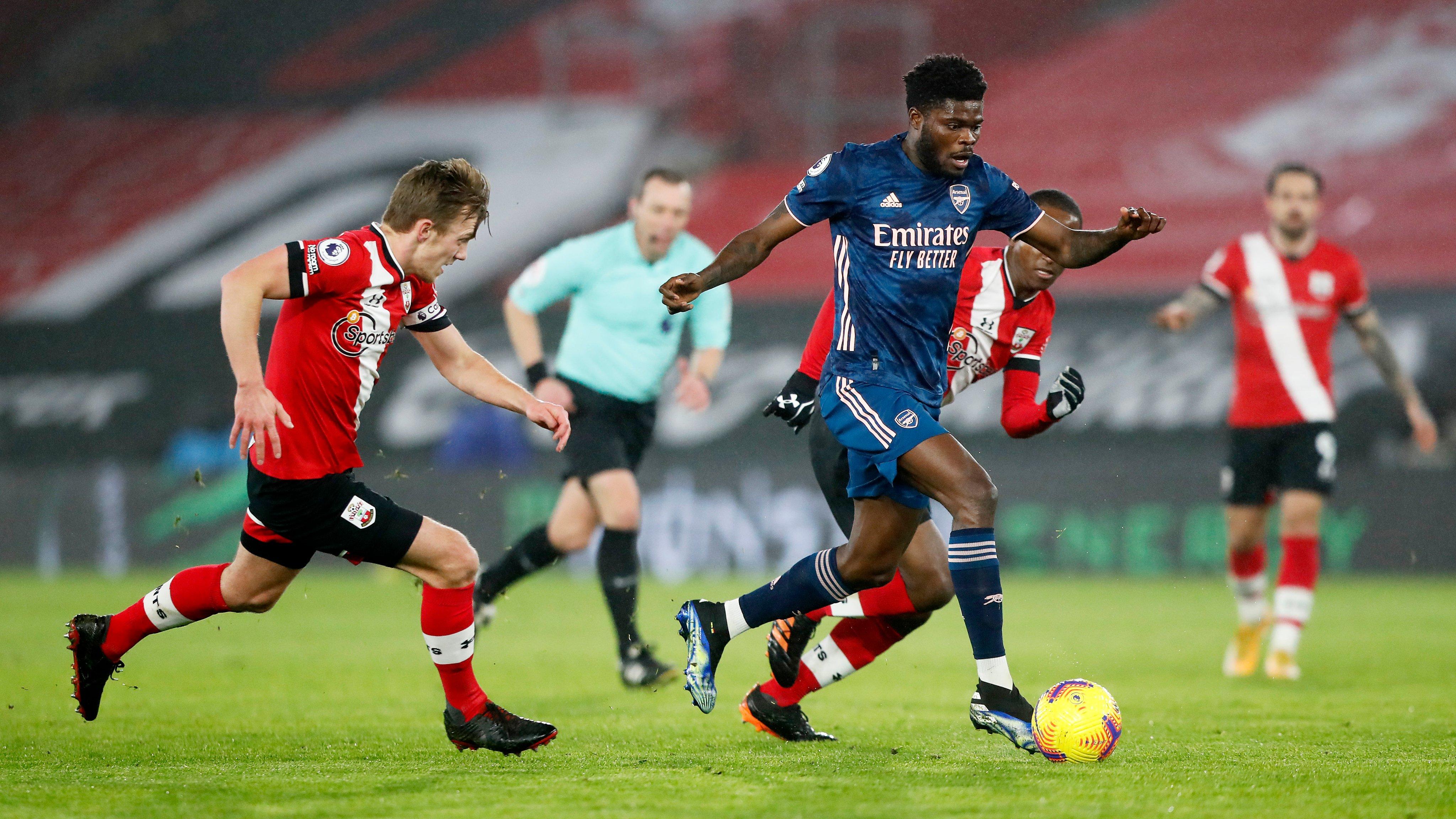 Thomas Partey runs at the Southampton defence