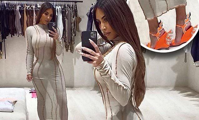 Kim Kardashian models skintight sheer dress and Prada flame wedges in sultry mirror snaps Photo