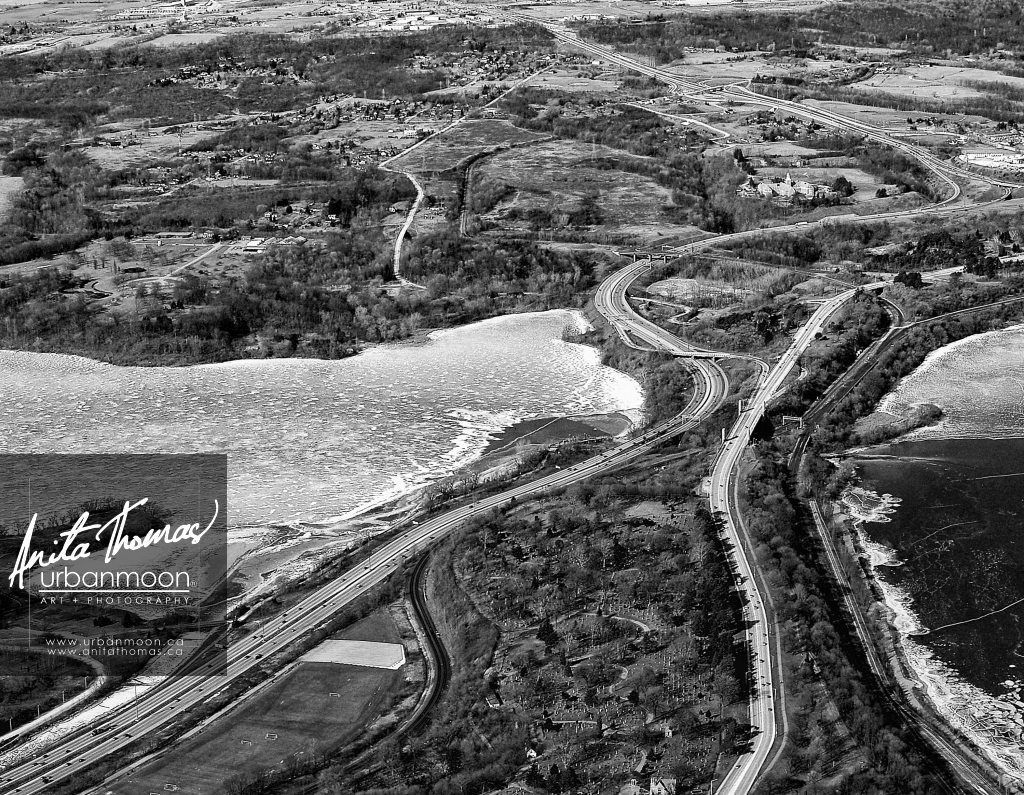 The 403 winding through Cootes Paradise and Burlington Bay in #HamOnt on a cold winter day, this one shot January 1, 2010.   #aerial #photography #winter #nature #BurlON #lake #ice #snow #CessnaViews