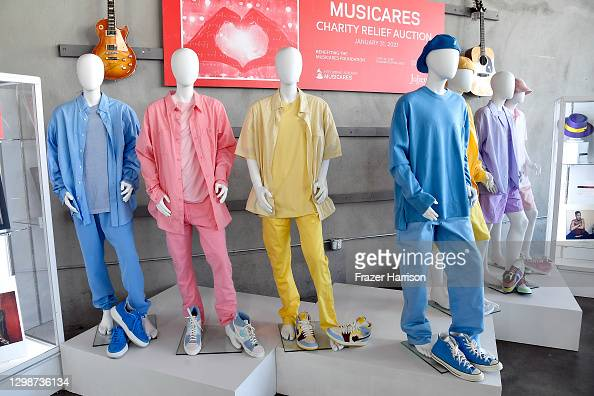 "Costumes worn by BTS in music video ""Dynamite"" are displayed at MusiCares Charity Relief Auction Press Preview at Julien's Auctions in Beverly Hills, California.  More 📸 #BTS 👉  @bts_bighit @BTSW_official"