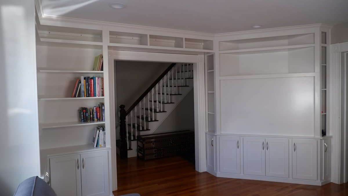 We so enjoyed creating this custom #wallunit for a customer's home. They now have the perfect place to beautifully display their book collection. Plus, a special, custom space to house their TV. #bookcase #bookshelves #entertainmentcenter #familytime #familyroom #TVroom