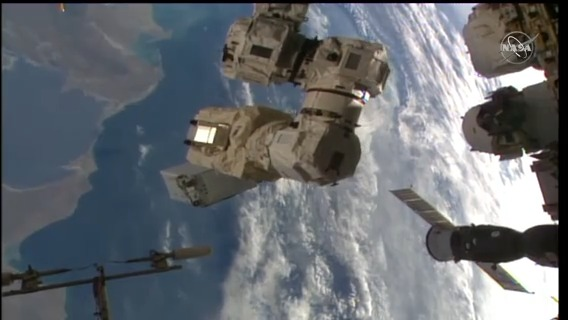 What a ride! @AstroVicGlover is being maneuvered by the Canadarm2 robotic arm to join @Astro_Illini on @ESA's Columbus module 263 miles above the Earth. #AskNASA  