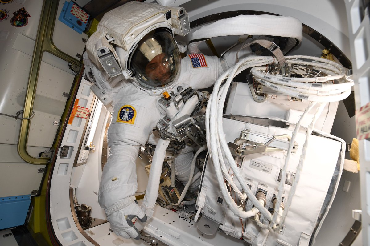 Are you watching?! @AstroVicGlover is already outside @Space_Station for his very first spacewalk, with @Astro_illini. Here he is pictured in the airlock with the new antenna they are installing on the Columbus module. Tune in on NASA TV