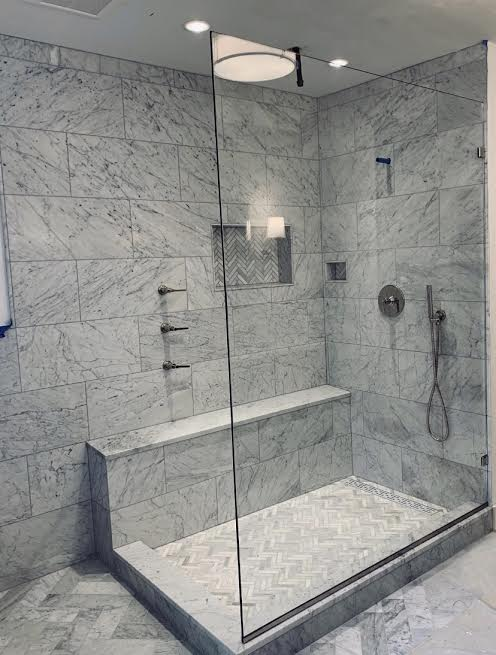 Check out this modern shower our teams created! Is this single glass panel your style? #wednesdaythought