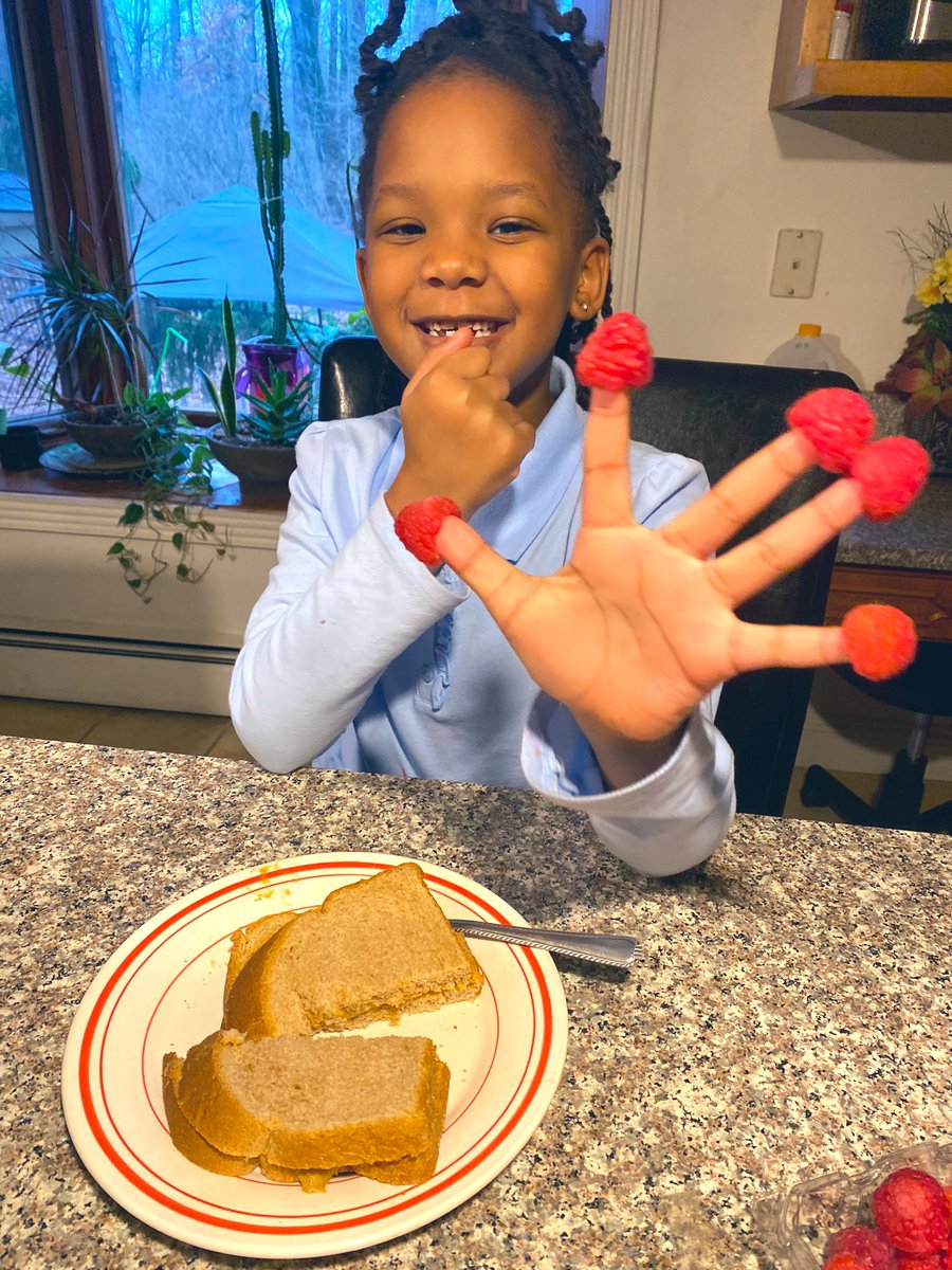@dionnewarwick My baby girl so proud of her raspberry fingers...an after school snack! #dionnewarwick