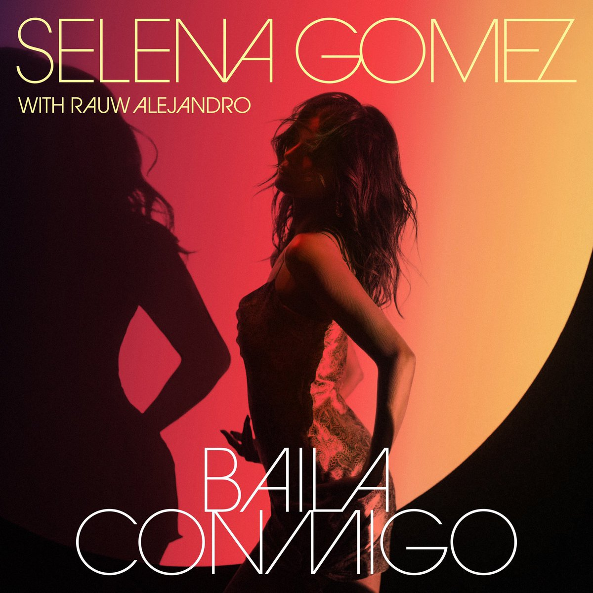 """Her Spanish-language era continues! @selenagomez is teaming up with @rauwalejandro for a new single called """"Baila Conmigo"""":  🔥"""