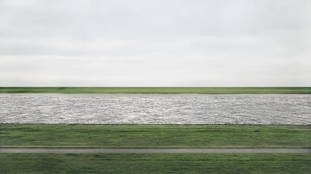 Here is a world in which the secret seems to be crying aloud but I cannot hear it. Days spent thinking about this photograph that pictures itself and leaves everything else in a blur. A partial thing that is complete but leaves room for newcomers. Andreas Gursky; Rheinn II; 2011.