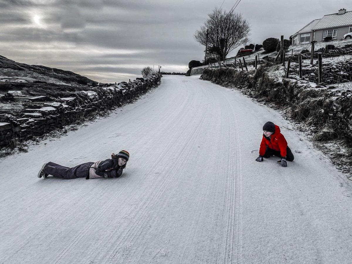Sliding their way to town #kilcar #sneachta #snowday