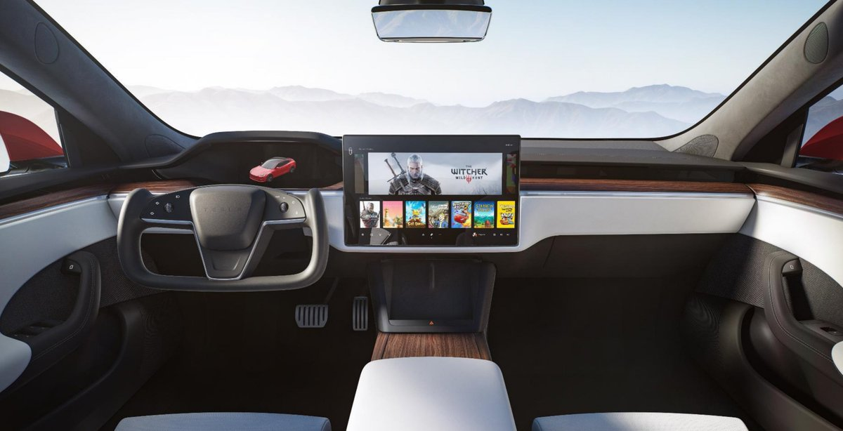 Initial interior reaction: Looks pretty sweet. They had to switch to the horizontal screen eventually to make software development easier.  That steering wheel... not so sure it's a good idea?  Wireless chargers 👍🏾 NO BLINKER STALKS? Backseat screen is nice!