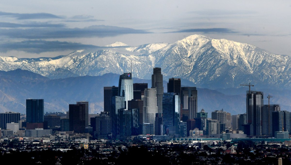 Downtown Los Angeles with the snow cap mountains from Kenneth Hahn State Recreational Area in Los Angeles on Wednesday, January 27, 2021. #moutains #snow #losangeles #california