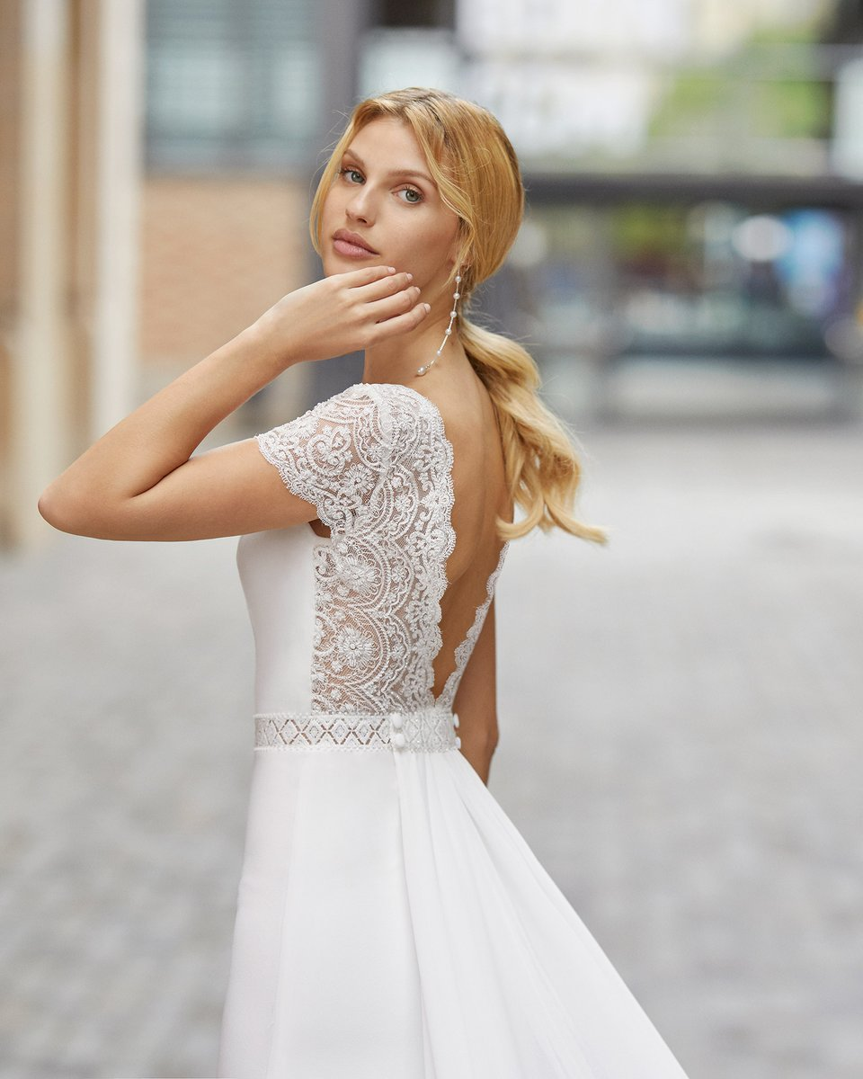 Enchant your guests in our sweet Talina dress! The crepe is beautifully figure-hugging, and the delicate lace detailing at the waist gives a stunning definition - to make you feel magical! #AnEverlastingDream #RosaClara2021 #RosaClara #NewCollection #WeddingDress #Wedding