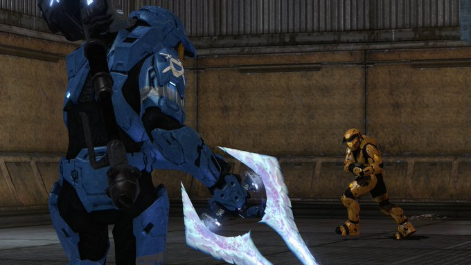 A blue Spartan with an Energy Sword faces down against a yellow Spartan wielding the Grifball.