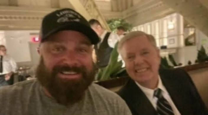 @mmpadellan Here's Lindsey having a selfie with Joe Biggs, criminal insurrectionist and Proud Boy leader. So yeah, he DEFINITELY doesn't want to bring in the FBI to reveal everything they've dug up so far...