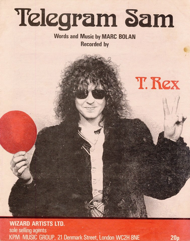 "MARC BOLAN ~T. Rex 1972 Feb. 5th ""Telegram Sam"" hits #1 on UK chart. 1st record on Marc's own label. This song has been covered by many bands. T. Rex rockin' it live at historic Wembley here: 🎸🎶#marcbolan"