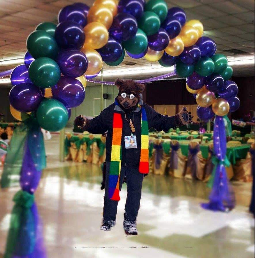 """#Waldolf standing under a #MardiGras #balloon #arch. But apparently there is no one else there to party with yet. Maybe because he is a week late for #fatTuesday? :)  photo via the internet and """"Photoshop"""" #fursuit #fursuiter #fursuiting #bear #costume"""