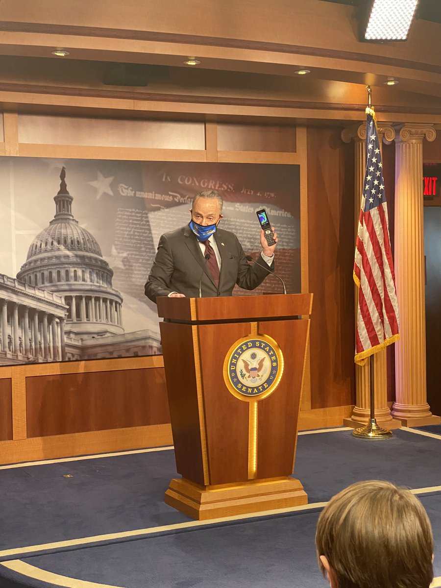 Schumer shows off his flip phone