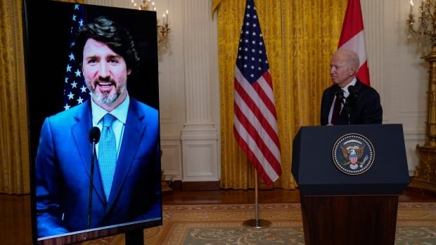 Biden, Trudeau pledge to counter China, climate change, in warm first meeting Photo