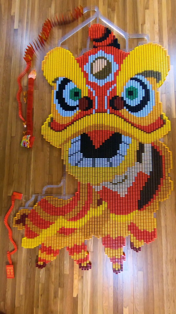 "A ""lion dance"" made up of over 8,000 dominos in honor of #LunarNewYear      See it in action –>"