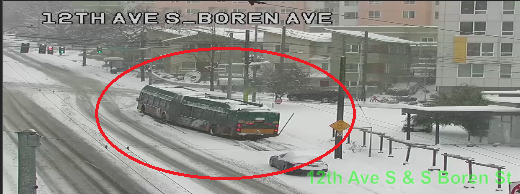 There is a blocking vehicle on Boren Ave at Yesler Way blocking the northbound right lane. Use caution.