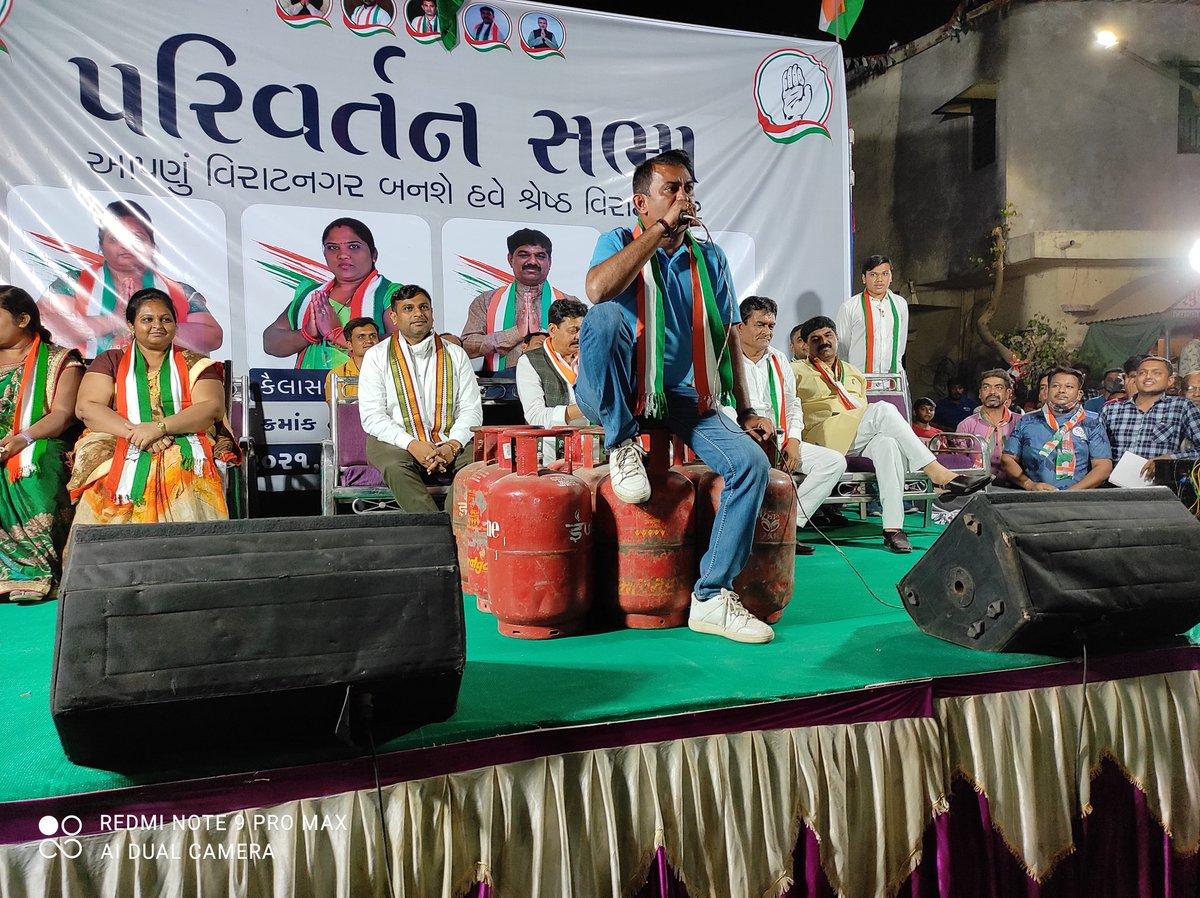 Dhanani addresses public meeting sitting on LPG cylinder