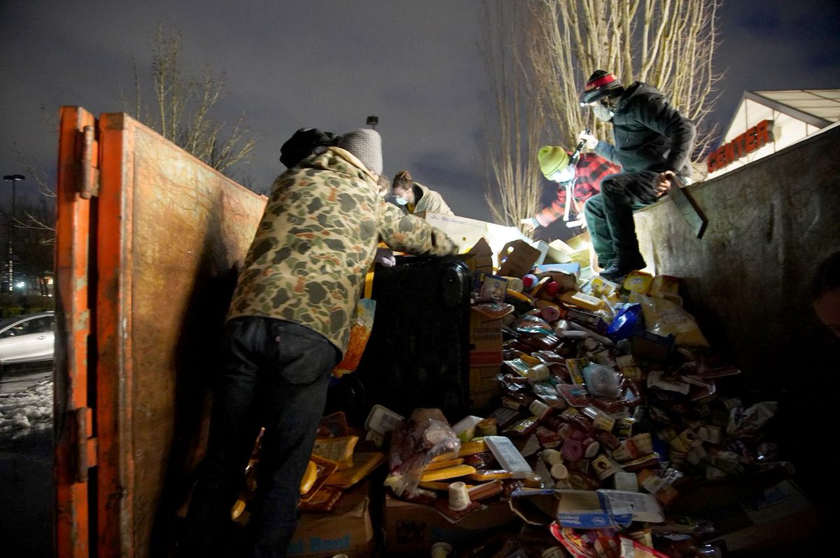 Portland police guard dumpster, face off with residents trying to get discarded food from Fred Meyer