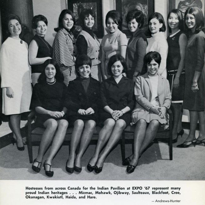 A black and white photo of 13 of the young Indigenous hostesses from across Canada for the Indian Pavilion at EXPO '67. Nine stand in the back row and four are seated in the front row. photo credit: United Church of Canada Pacific Mountain Region Archives