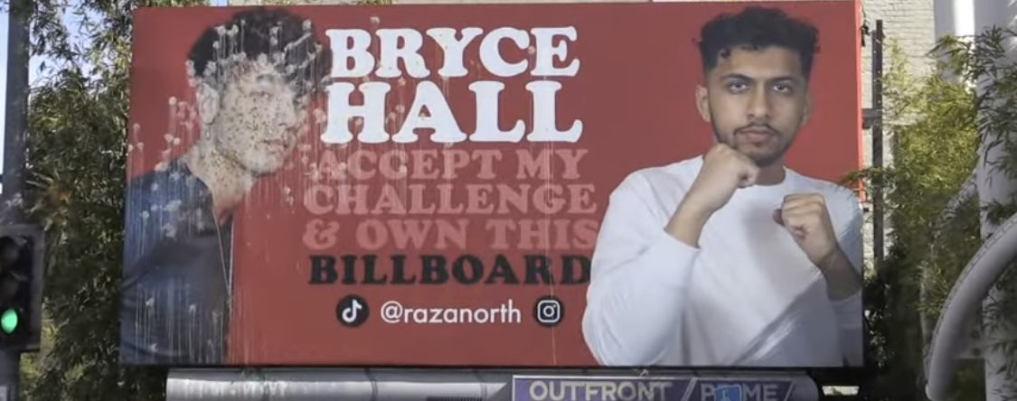 I'll give $2500 to someone who tells me who vandalized my face on this billboard...