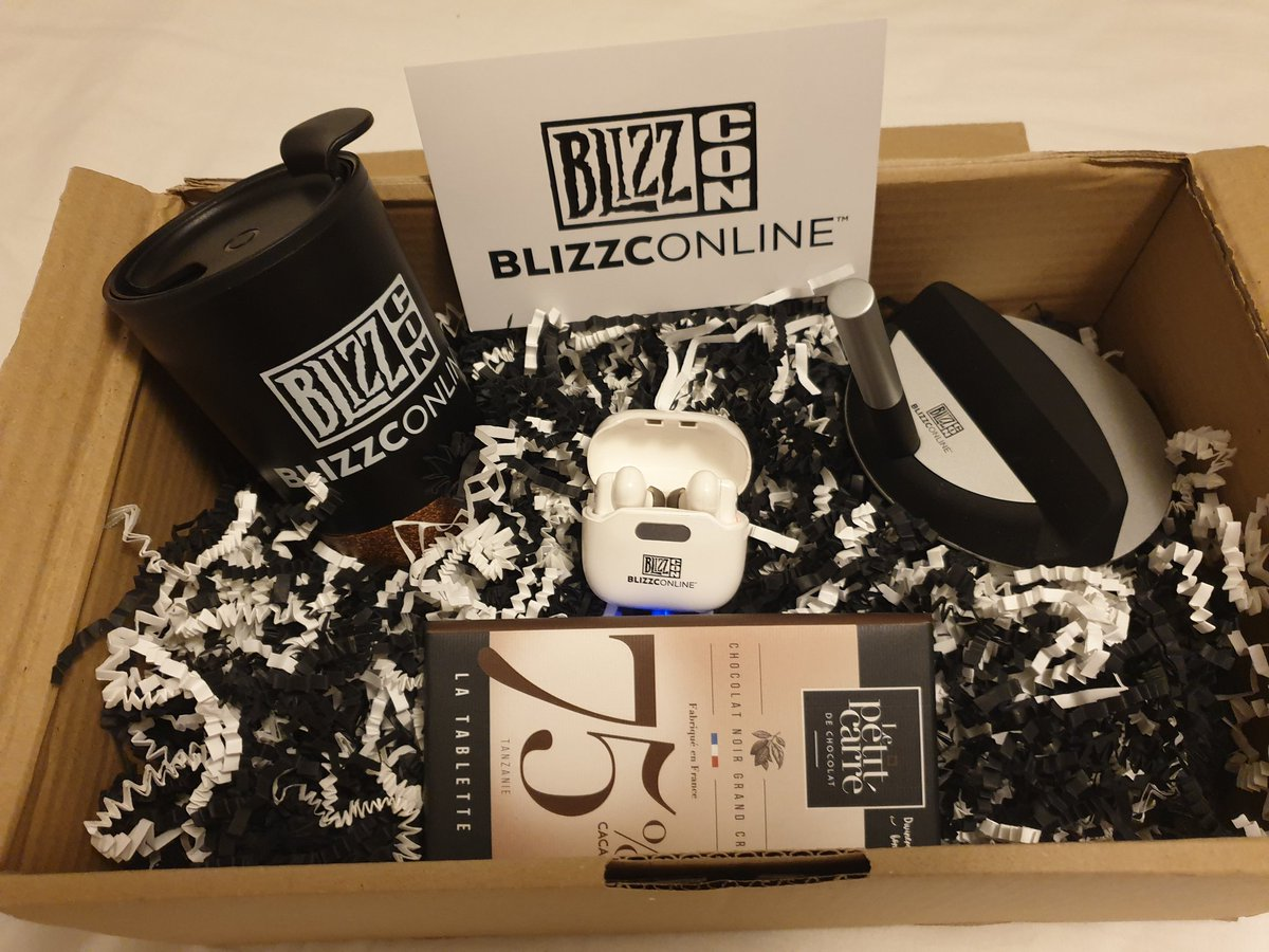 Treckie - Blizzconline in T minus 2hour 30! What an amazing blizzconline goodie bag straight from blizzard!  @Allidorables will def steal the coffee mug, and I'm positive Nora will taste test everything else.