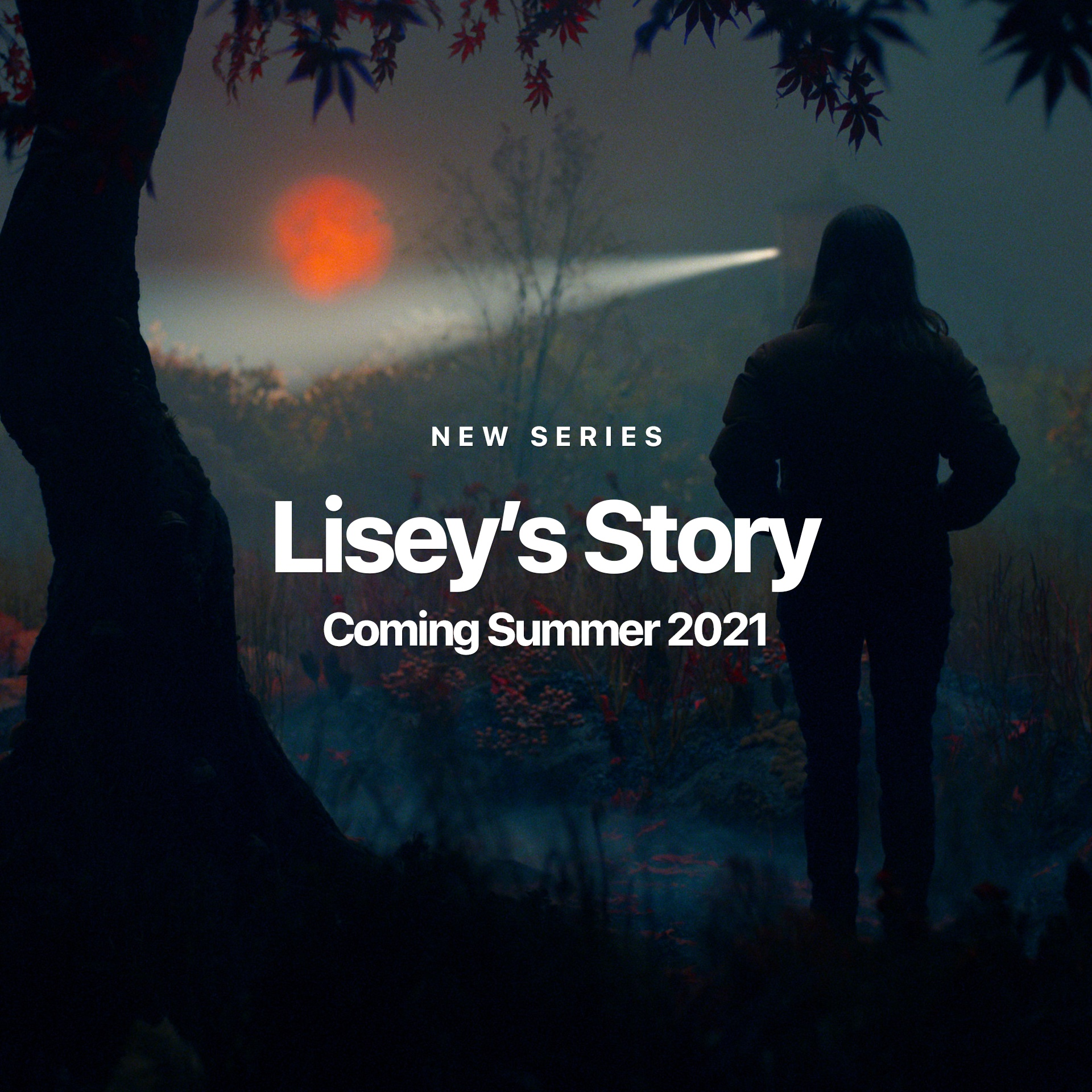 The dark figure of a person walks into the foggy, eerie night with a glowing orange orb in the distance in a still pulled from the Apple Original series, Lisey's Story.