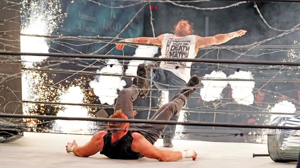 Omega is drop kicked into the ropes
