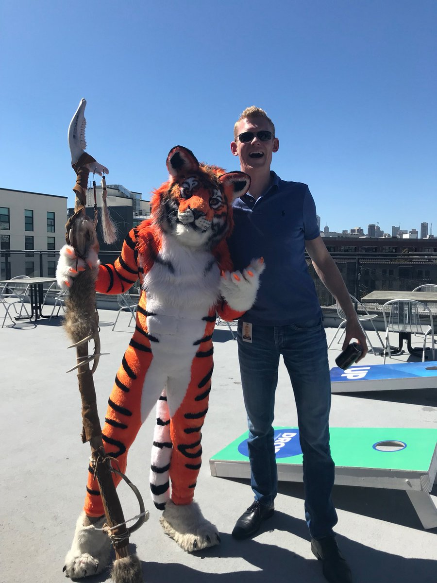Spotti suiting at work for #FursuitFriday. On roof of our San Francisco company (L), and being interviewed by lead tech columnist of London Times (R)