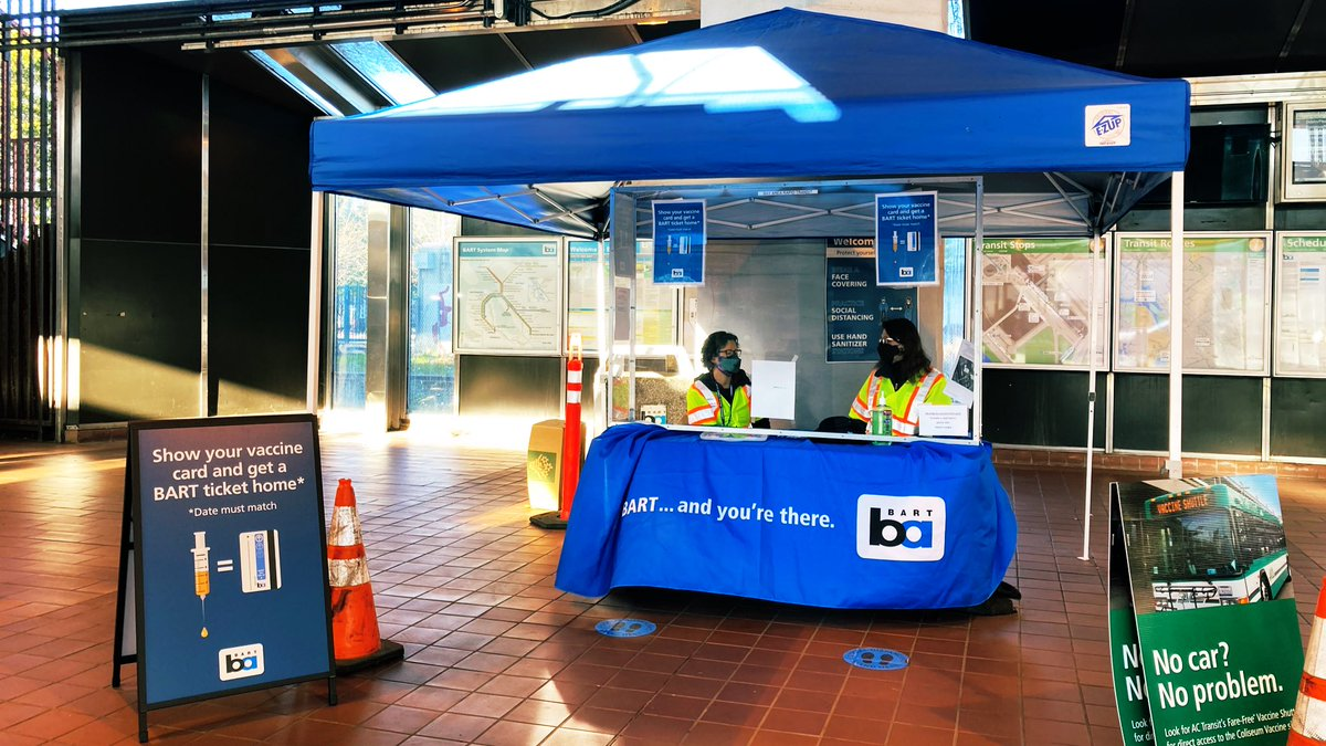 """If you're not sure where to go once you exit the train, @SFBART staff are at a table just outside the turnstiles, and they'll point you to where to go. Notice the sign: """"Show your vaccine card and get a BART ticket home."""" #CovidVaccine #Oakland #BayArea"""